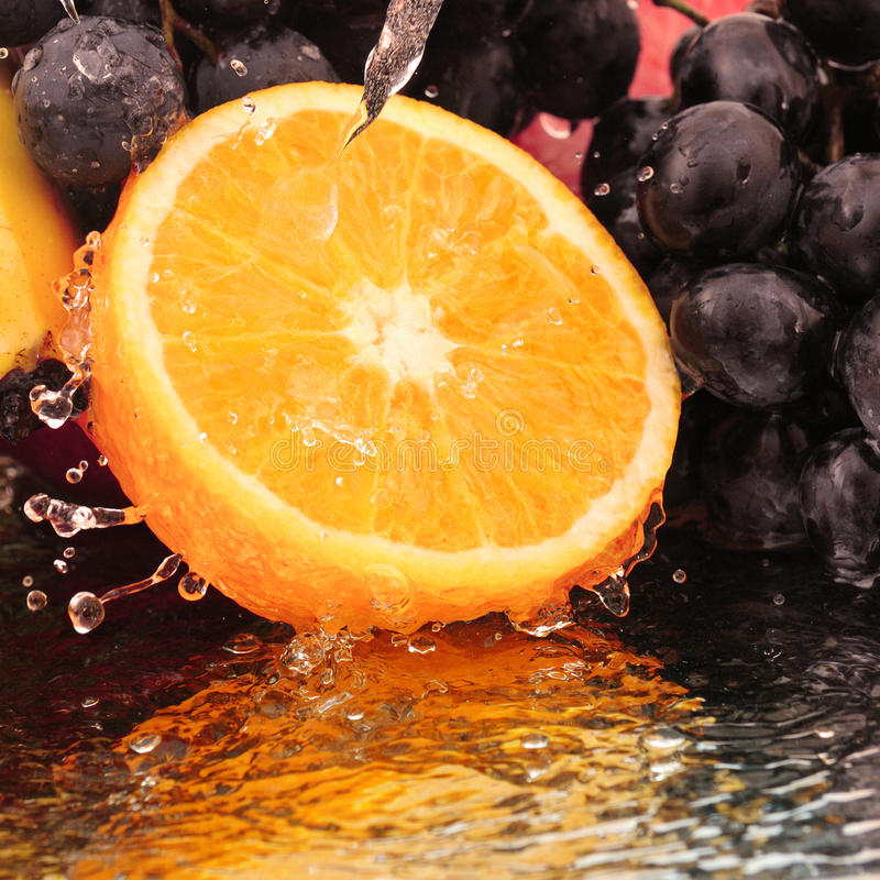 Pure fruit. In a spray of water royalty free stock photography