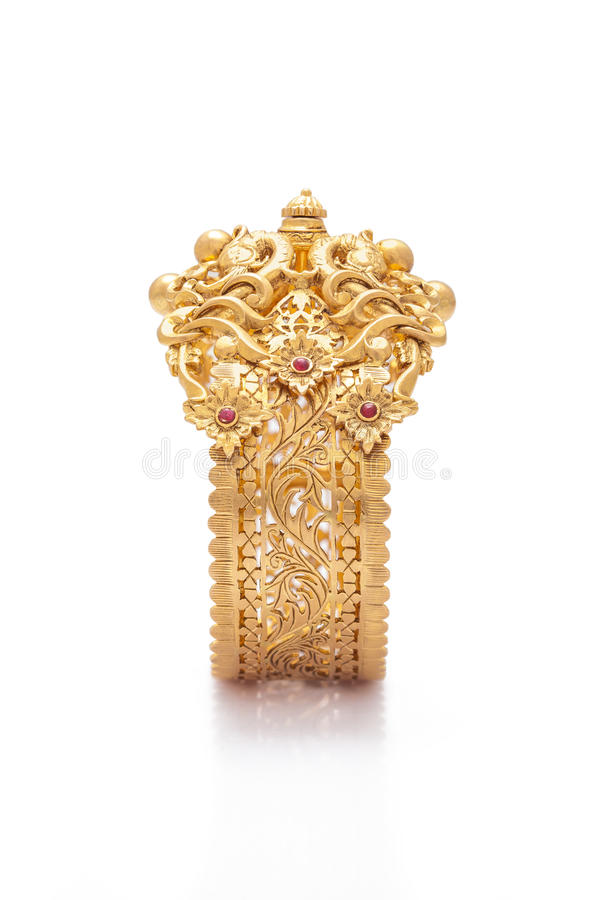 Pure Gold bracelet. Having itself craft of gold looking historic over blackwhite background stock photo