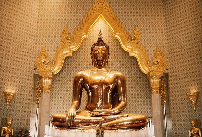 Pure gold Buddha sculpture at Wat Trimitr in China town Bangkok, Thailand stock images