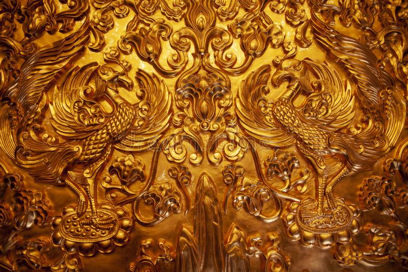 Pure gold double phoenix totem in luoyang, China stock images