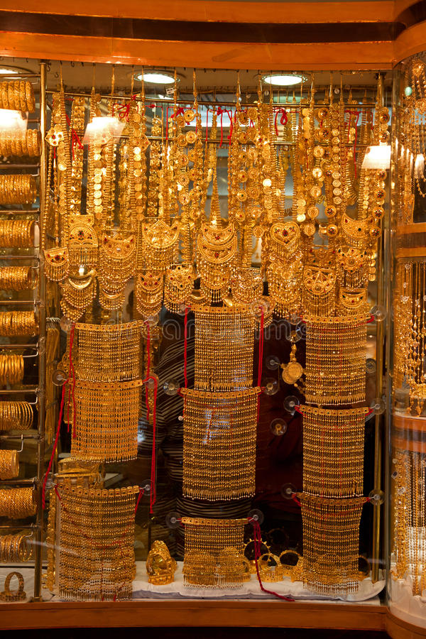 Gold Souk - Pure gold. Gold jewelry display in window of souk in Dubai royalty free stock photography