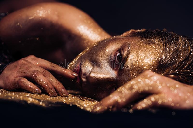 Pure gold. Vogue and glamour concept. Golden skin. Sexy girl face makeup body art metallized color. Spa wellness. Richness and wellbeing. Golden mask. Luxury royalty free stock photos