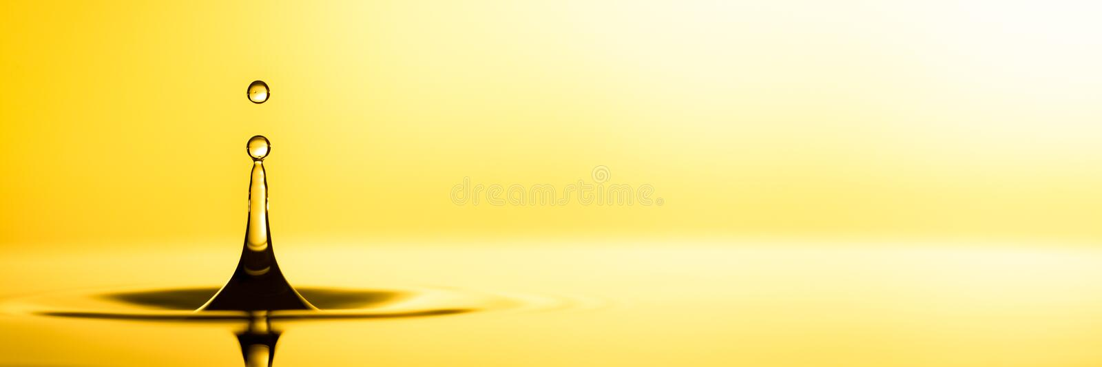 Pure Golden Oil. Splashing Into Puddle royalty free stock photo