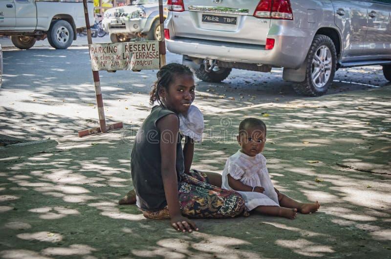 A pure homeless family on the ground. Madagascar, Toamasina stock image