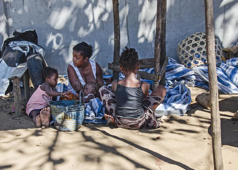 A pure homeless family on the ground. Madagascar, Toamasina royalty free stock image