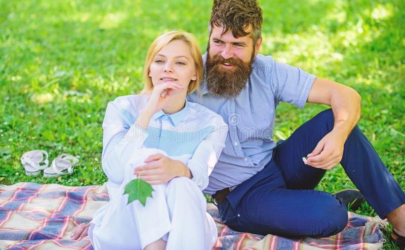 Pure nature. Couple with green leaf relax natural environment. Couple bearded man and woman enjoy nature while sit on royalty free stock images