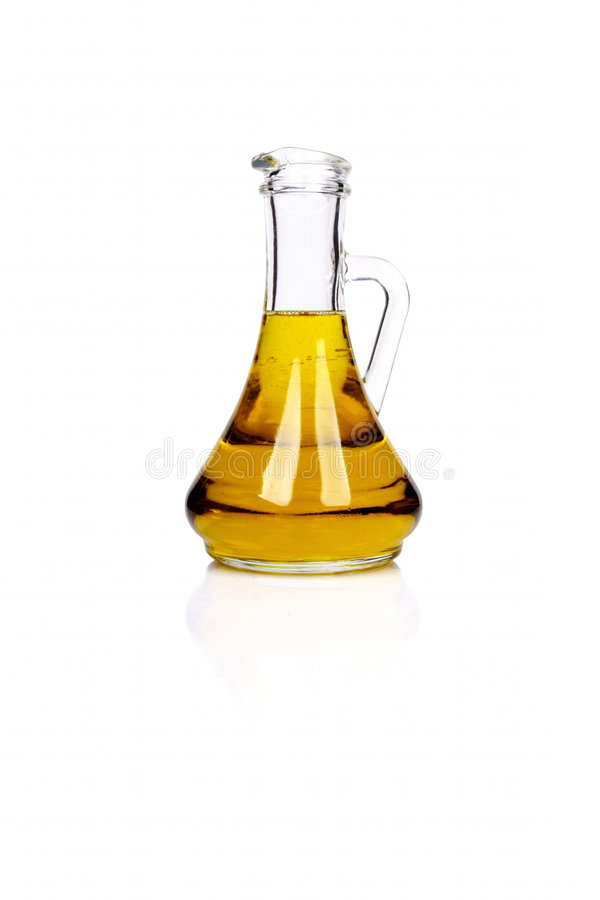Pure olive oil. Bottle of pure olive oil royalty free stock photo