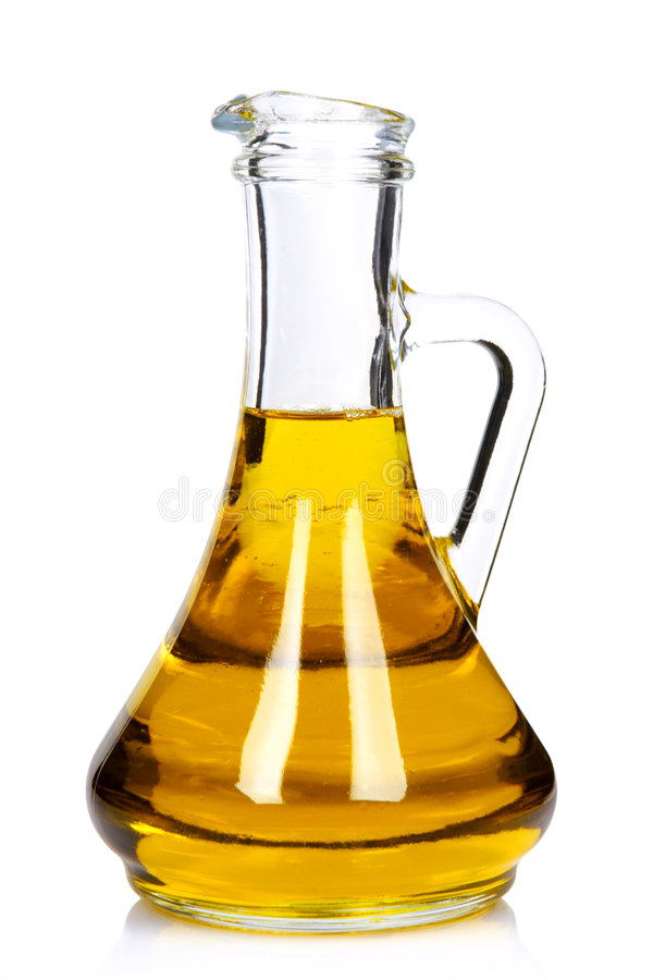 Pure olive oil. Bottle of pure olive oil royalty free stock photos