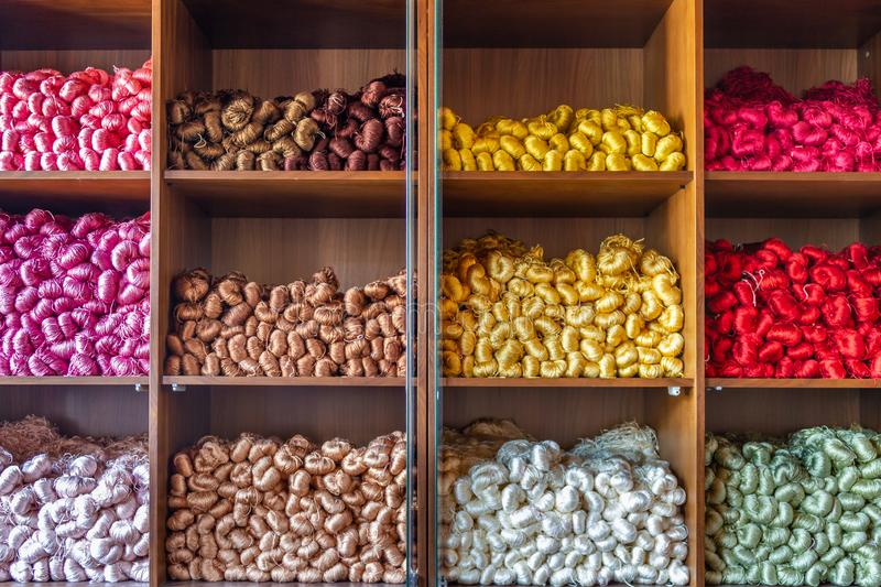 Pure silk yarns in various colors in the shelf stock image