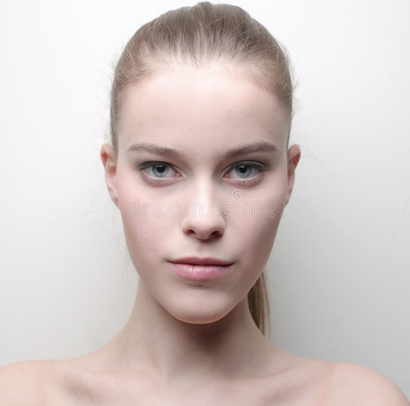 Pure skin. Blonde girl with a pure skin royalty free stock photography