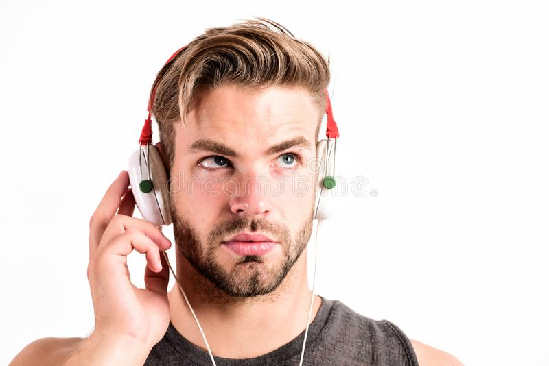 Pure sound. Modern earphones. Inspiring music concept. Man handsome unshaven hipster listening song using headphones stock image