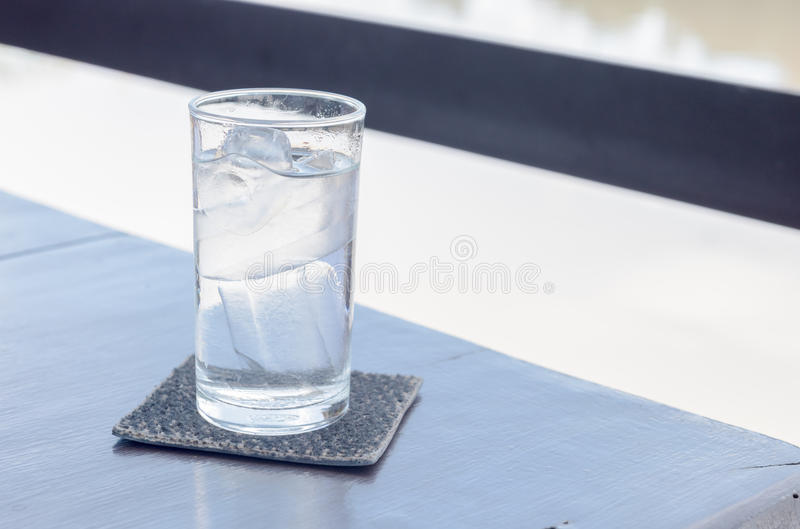 Pure water with ice in glass. On table royalty free stock photography
