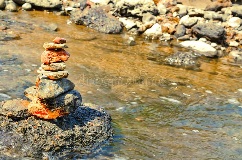 Pure water and stone tower beautiful view. Stone tower at the valley in river,pure river water and stone Empire, health, mountain, blue, calm, zen, spa, green royalty free stock photo