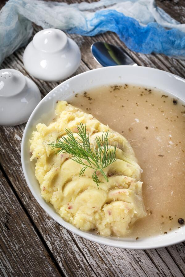 Pure white borscht. Served with mashed potatoes stock images