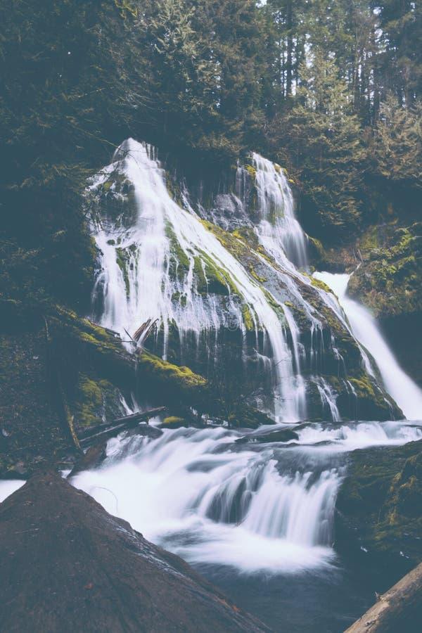 Pure white water stream down a rock intro river stock image