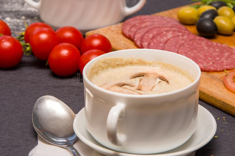 Puree soups, julienne soup with mushrooms and spinach, cherry tomatoes stock photo