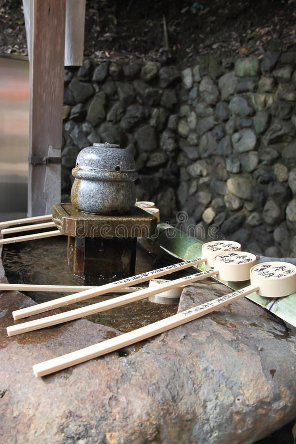 Purification fountain with ladle at a Japanese shrine royalty free stock photography