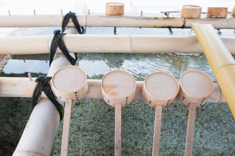 Purification fountain with wooden ladles in Shitennoji temple. In Osaka,Japan royalty free stock photography