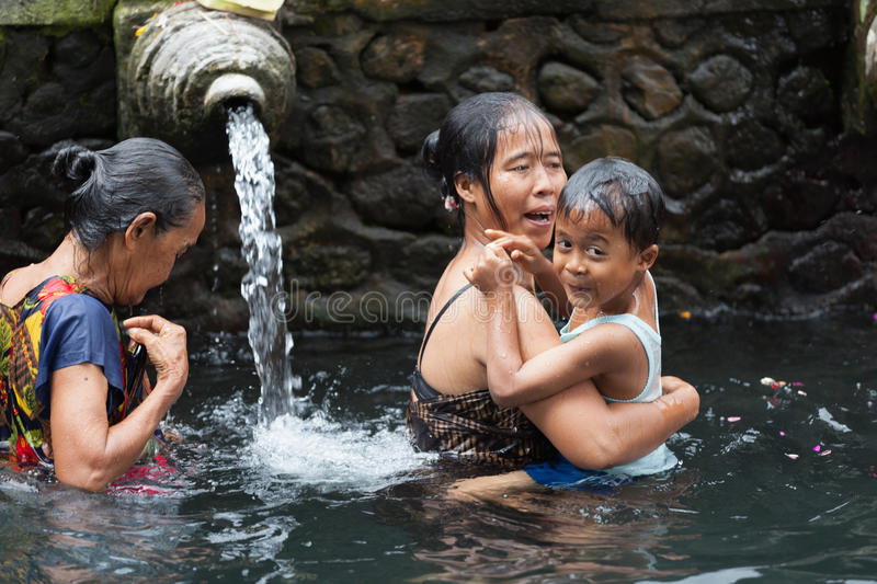 Purification In Sacred Holy Spring Water, Bali Editorial Photography