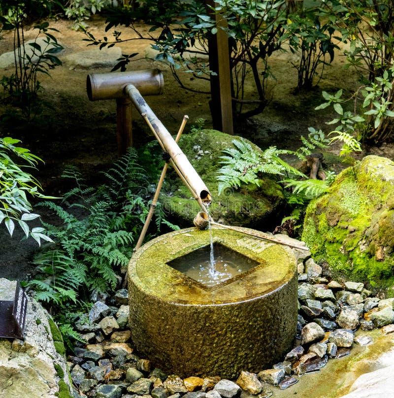 Purification water fountain at Ryōan-ji temple. Kyoto, Japan royalty free stock image