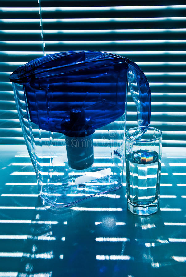 Purifying-filter and glass royalty free stock image