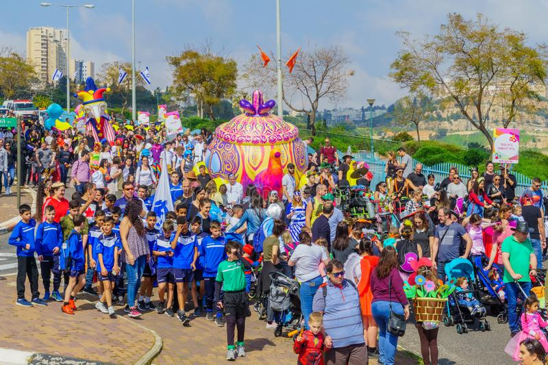 Purim Adloyada parade, in Nesher. Nesher, Israel - March 22, 2019: People, some in costumes, celebrate the Jewish holyday of Purim in the Adloyada parade, in royalty free stock photo