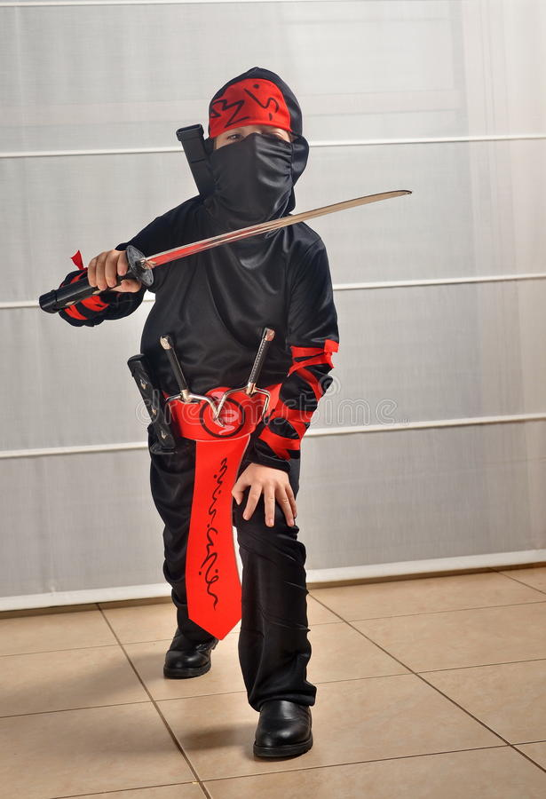 Purim (allhelgonaafton): Ninja Boy arkivfoto