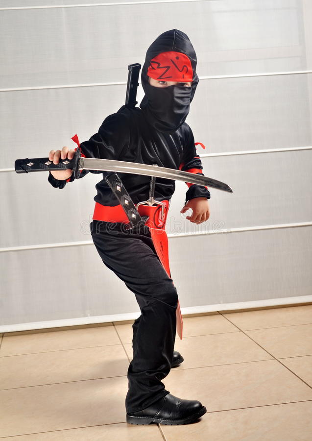 Purim (allhelgonaafton): Ninja Boy arkivfoton