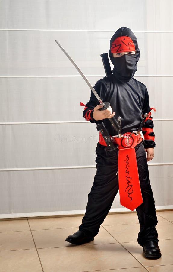 Purim (allhelgonaafton): Ninja Boy fotografering för bildbyråer