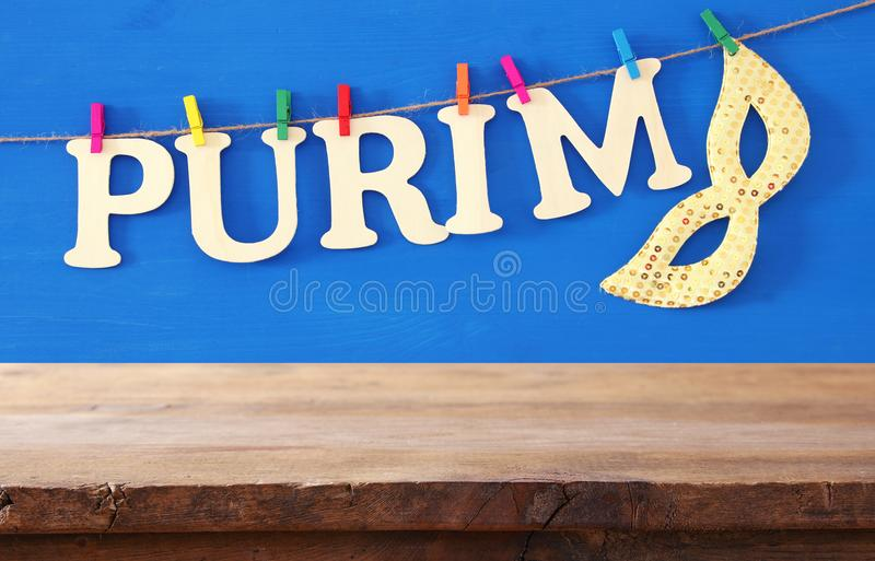 Purim celebration concept & x28;jewish carnival holiday& x29; in front of empty wooden table. product display backdrop. stock photos