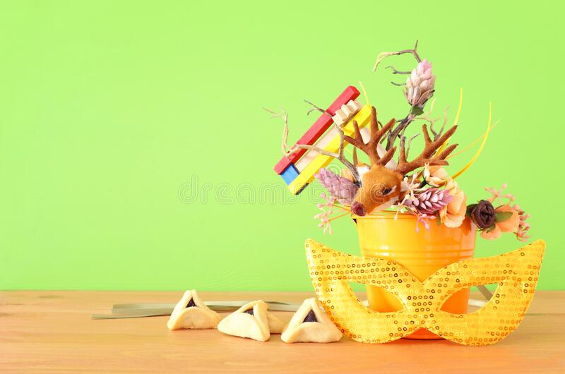 Purim celebration image jewish carnival holiday with traditional hamantasch cookies and deer antlers floral decoration over royalty free stock images