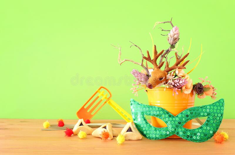 Purim celebration image jewish carnival holiday with traditional hamantasch cookies and deer antlers floral decoration over royalty free stock photo