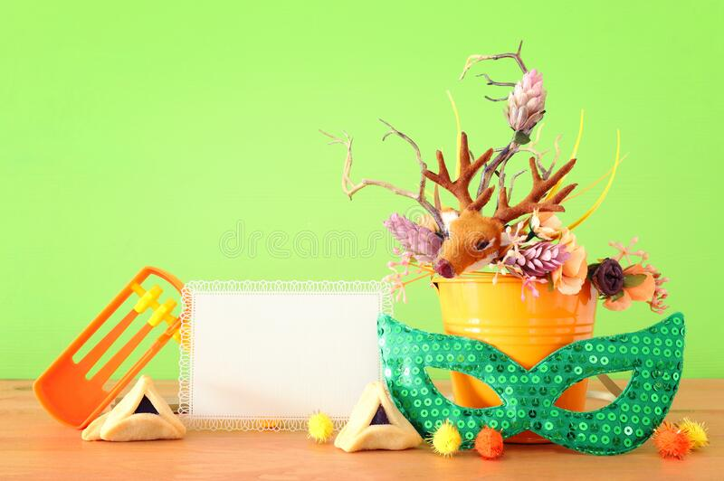 Purim celebration image jewish carnival holiday with traditional hamantasch cookies and deer antlers floral decoration over royalty free stock photography