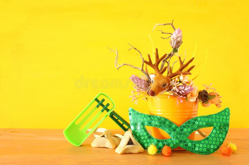 Purim celebration image jewish carnival holiday with traditional hamantasch cookies and deer antlers floral decoration over royalty free stock image
