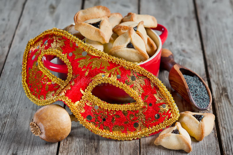 Purim. Hamantaschen cookies or Haman's ears and carnival masks for Purim celebration (jewish holiday royalty free stock photography