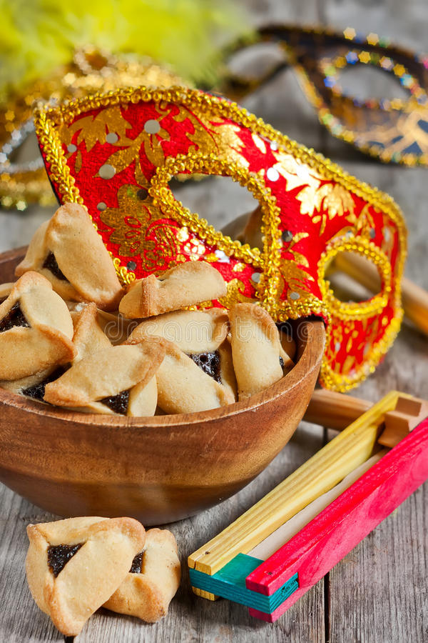 Purim. Hamantaschen cookies or Haman's ears, noisemaker and carnival masks for Purim celebration (jewish holiday royalty free stock images