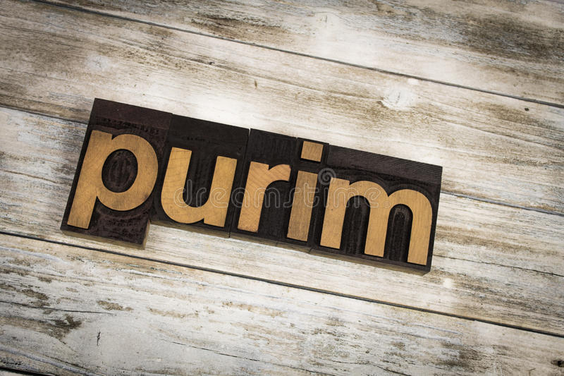 Purim Letterpress Word on Wooden Background royalty free stock photography