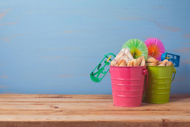 Purim traditional gifts with hamantaschen cookies and noisemaker stock image