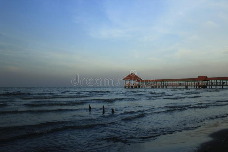 Purin Beach Pier in Tegal regency, Indonesia. Purin Beach Pier in Tegal regency, Indonesia, has beautiful sea, moderate waves and gentle beach breeze royalty free stock image