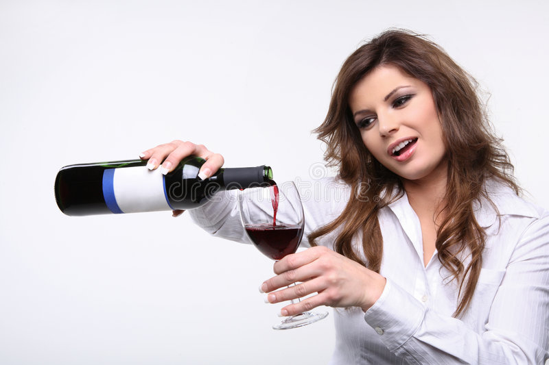 Puring red wine. stock images