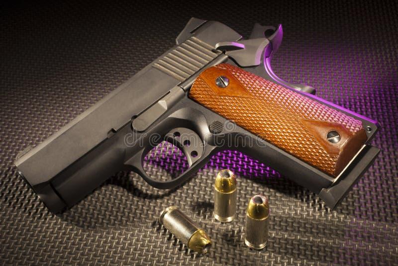 Purper benadrukt pistool stock afbeelding