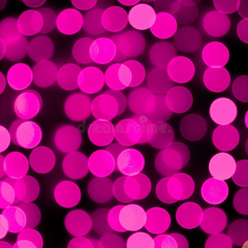 Purpere achtergrond van Unfocused de abstracte kleurrijke bokeh defocused en vertroebelde velen rond purper licht stock foto