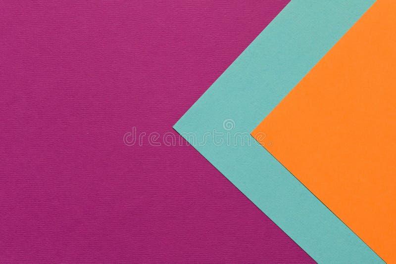Purpere oranje blauwe textuur als achtergrond van gekleurd document In c stock foto