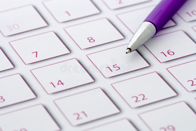 Purpere Pen op kalender 1 stock foto