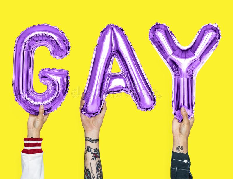 Purple alphabet balloons forming the word gay royalty free stock photo