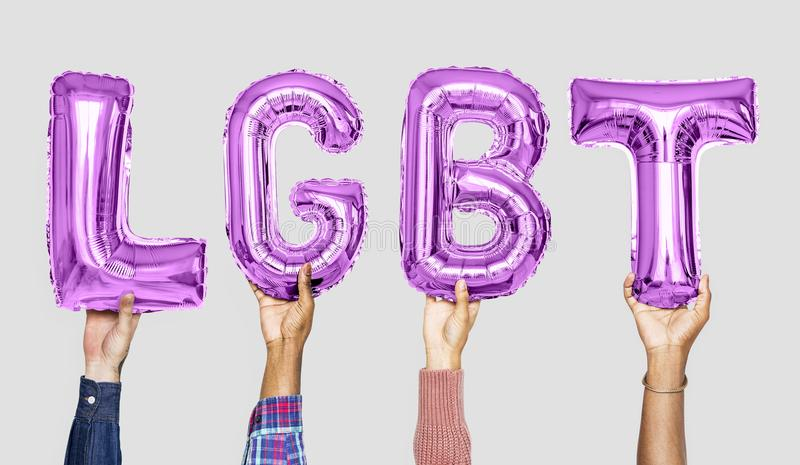 Purple alphabet balloons forming the word LGBT royalty free stock photos