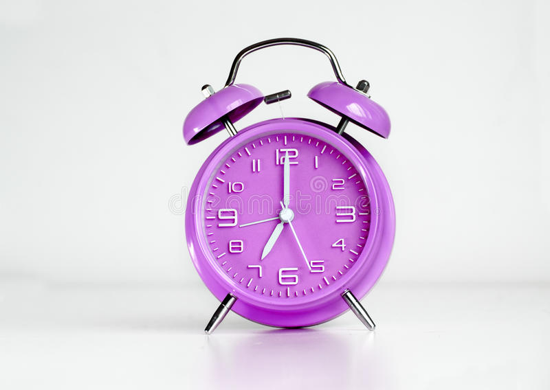 Purple analog retro twin bell alarm clock. Isolated royalty free stock images