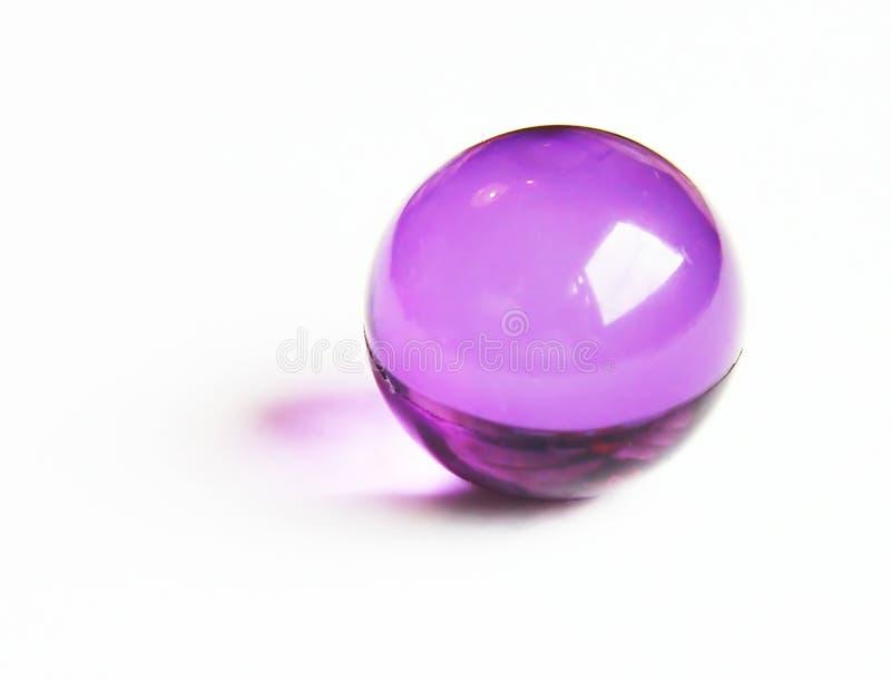 Purple bath ball stock photography