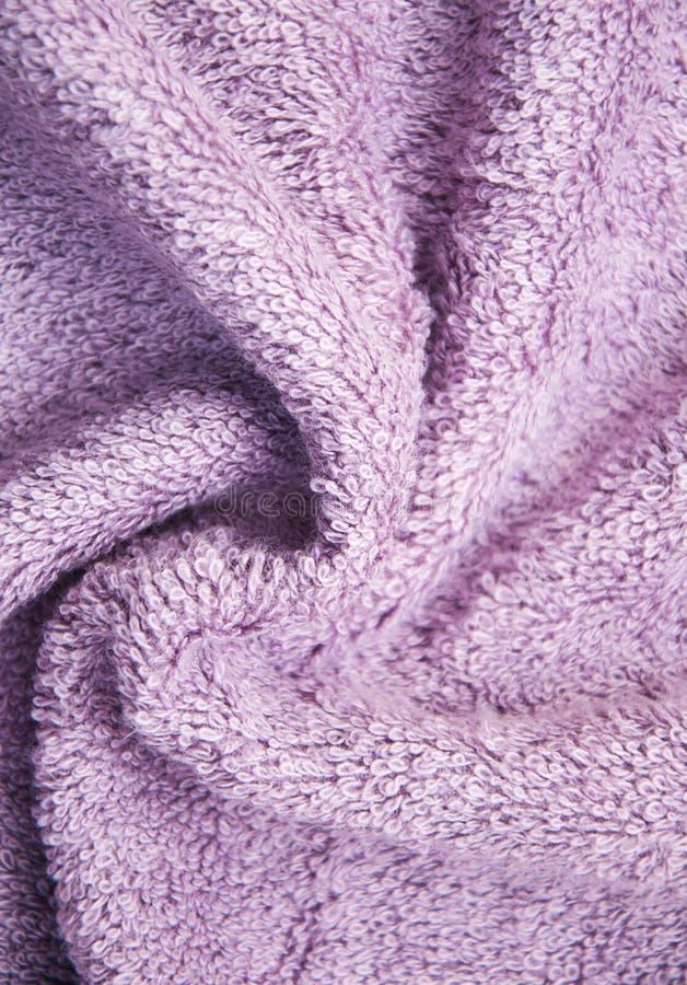 Purple bath fluffy towel stock images
