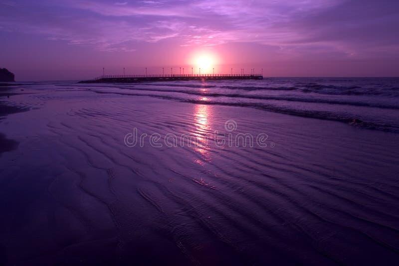 Purple Beach. Purple/magenta sunset on a beach royalty free stock images
